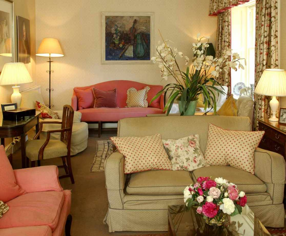 The drawing room has deep comfortable sofas