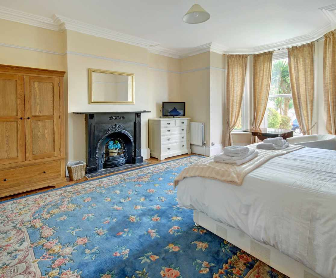 Bedroom 1 is extremely spacious and has an ornate feature fireplace