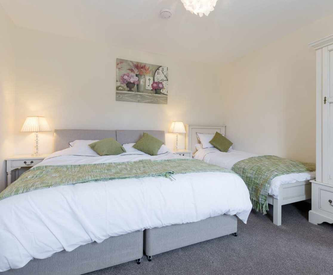 En-suite family bedroom with a double and a single bed