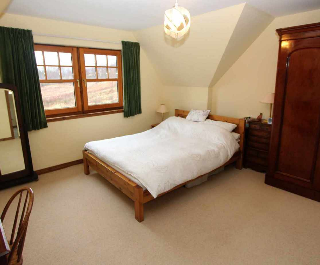 Room 2 is a large double bedroom on the first floor