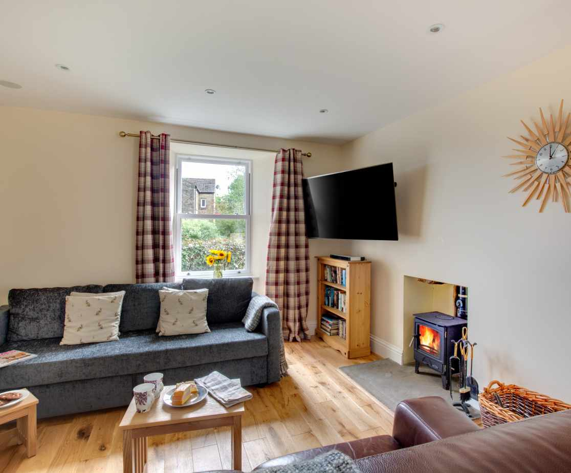 Snug with Smart TV, woodburning stove, a cosy room