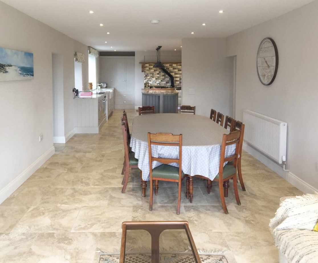 Spacious dining area adjoining garden room and kitchen