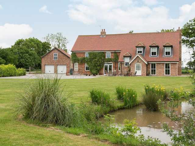 The house has 9 acres of grounds that include woodland and lakes