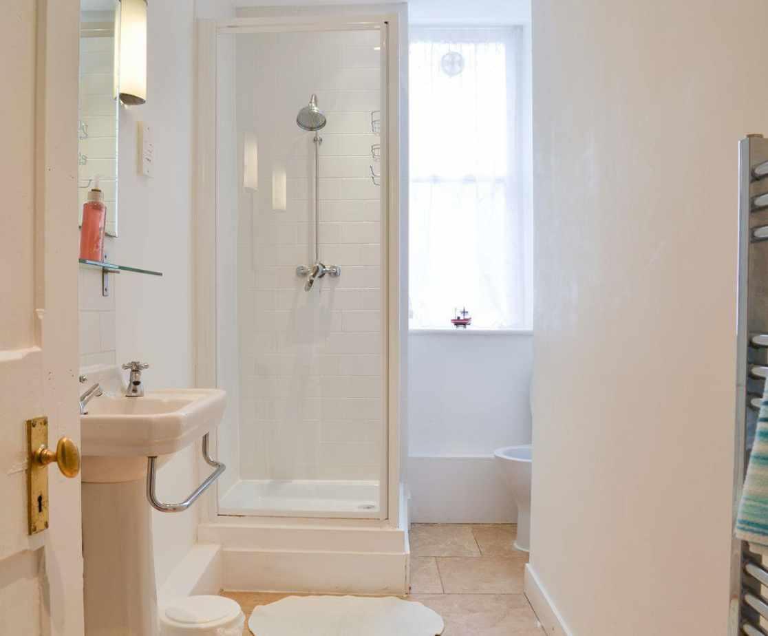 Shower room with heated towel rail