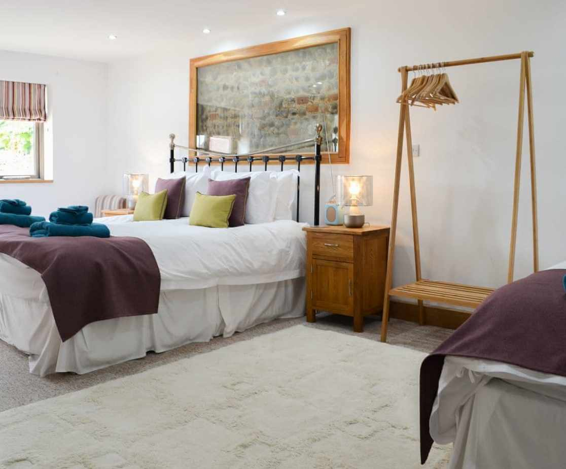 Bedroom with twin double beds