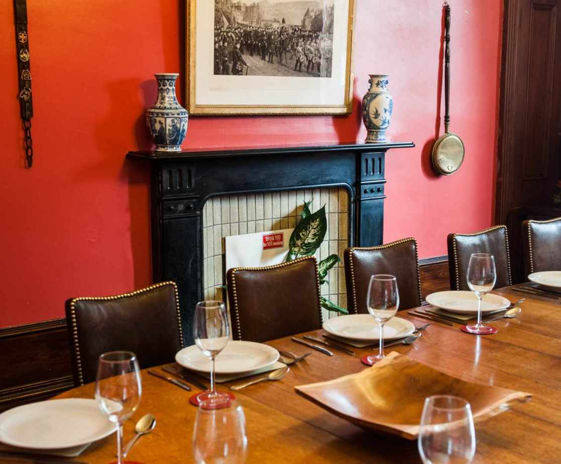 The dining room has a fine table that can seat 16 in comfort