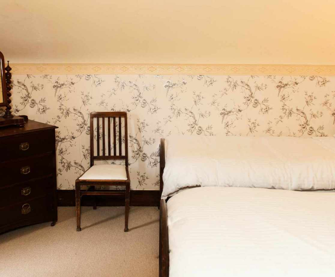 Room 4 is one of the two twin bedrooms on the first floor in the wing section