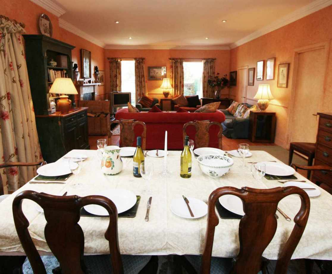 The elegant dining table seats 8 guests