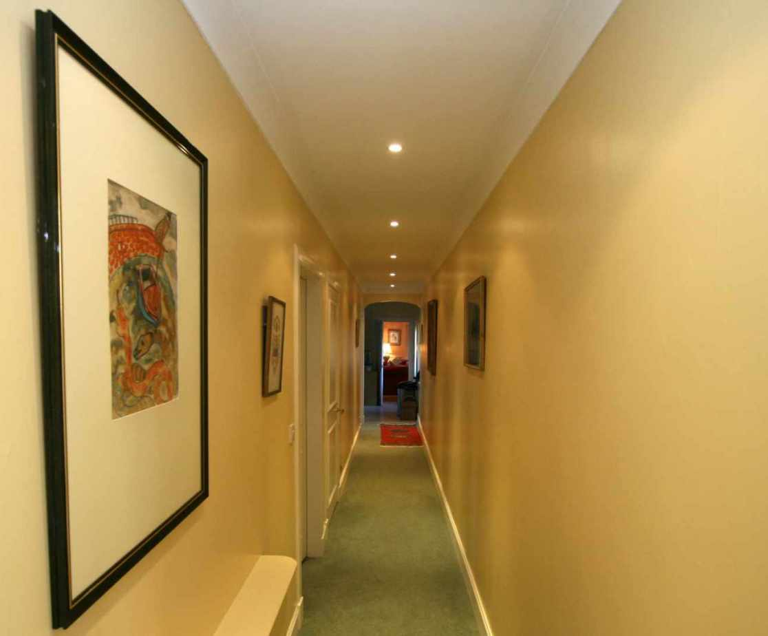 Three of the bedrooms are located off this hall