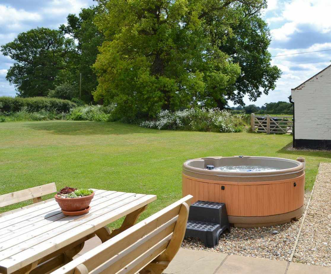 Relax in the hot tub in the private and secluded garden