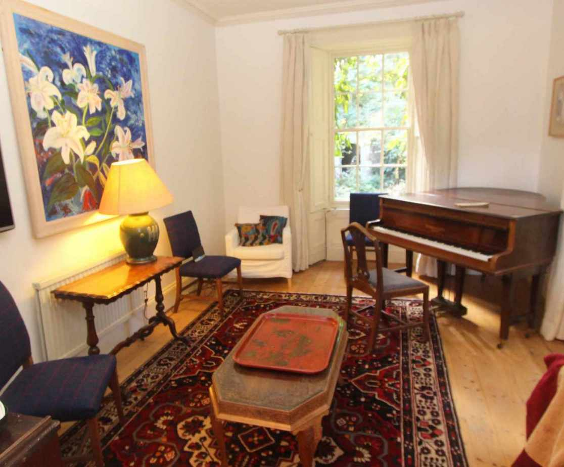 The drawing room also houses a TV and piano