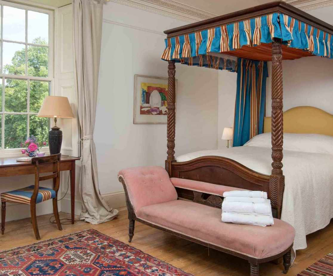 The \'Four Poster\' room is a stylish bedroom on the first floor