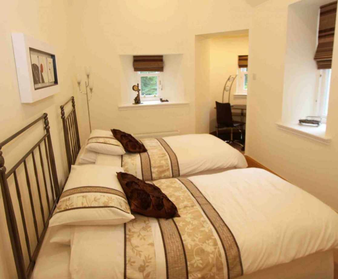 The \'Turret\' twin bedroom is a cosy bedroom