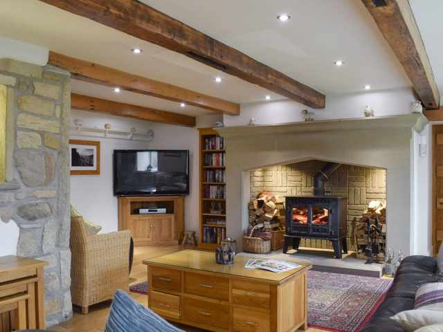 Characterful living area with wood burner