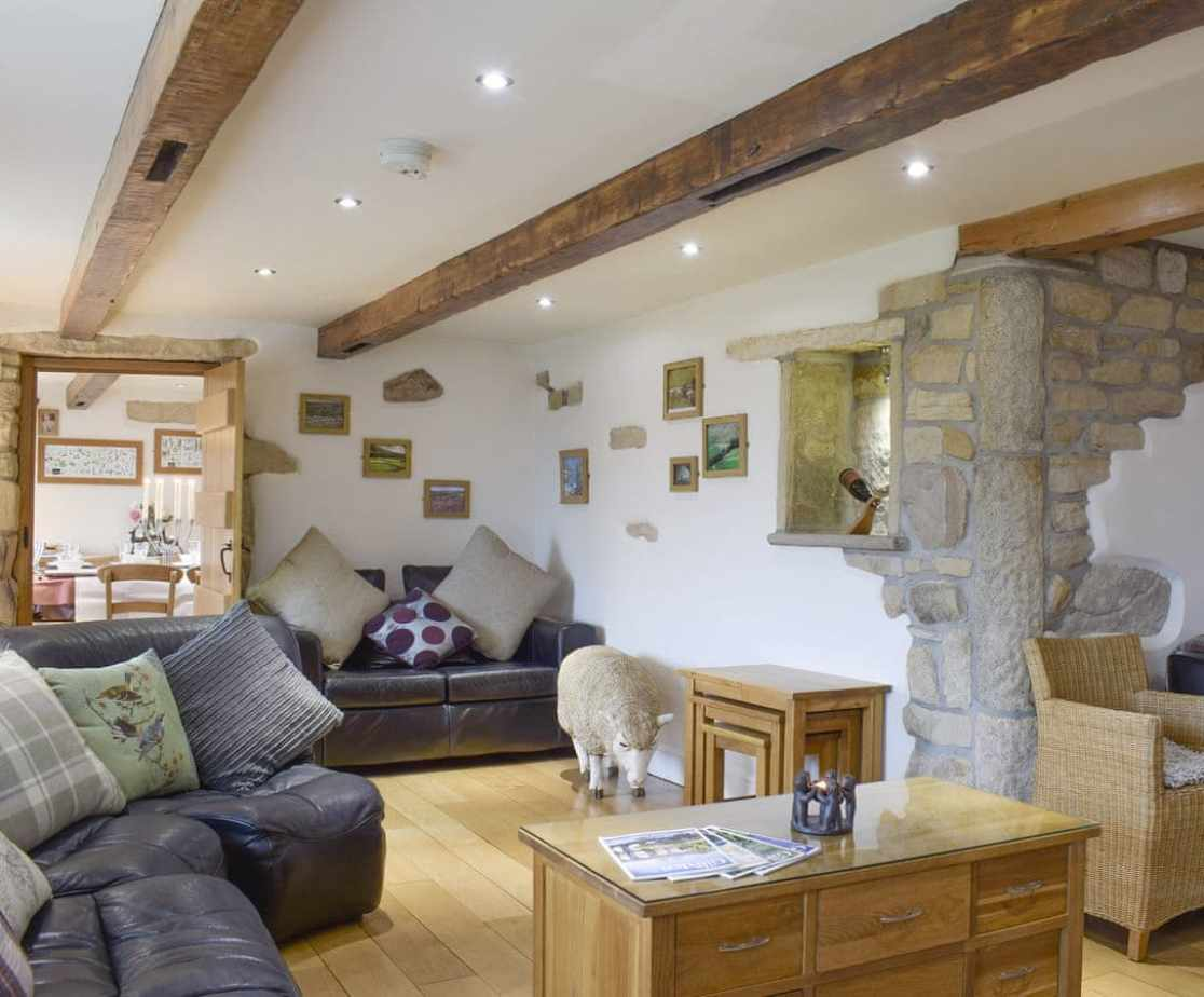 Spacious living area with exposed beams