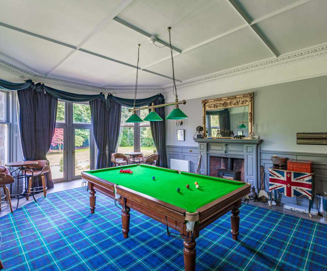 The Billiard Room is perfect for hours of entertainment, complete with Timothy Oulton Bar
