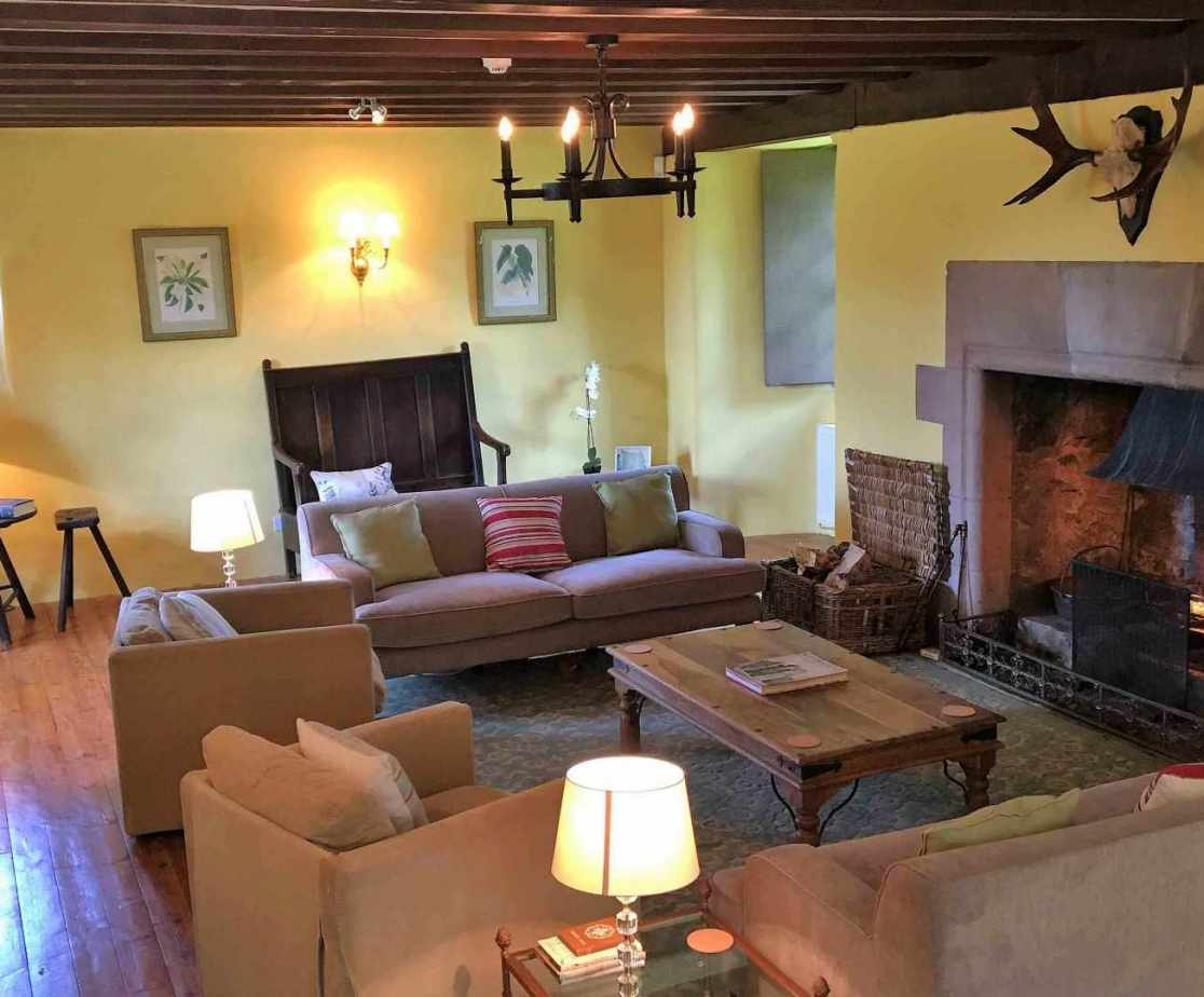 The sitting room with open fire is a comfortable room