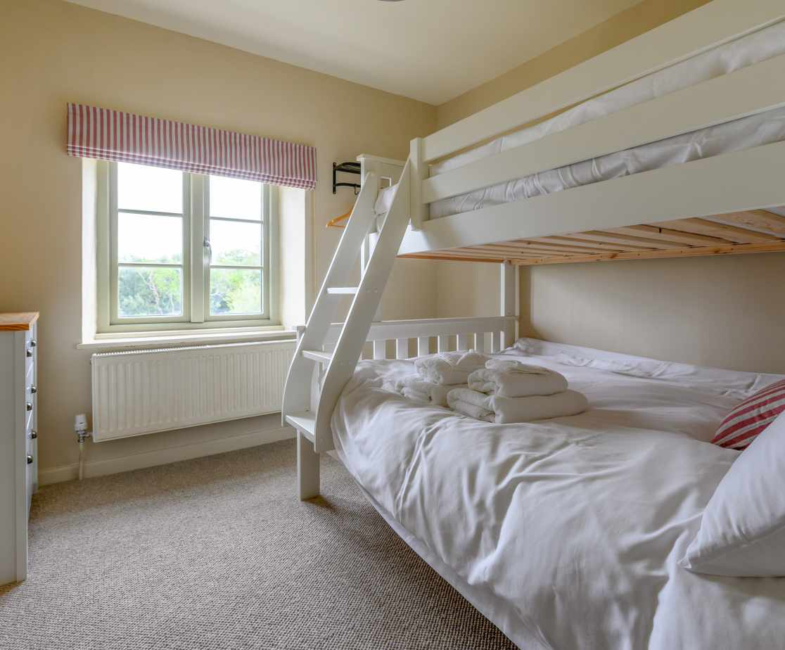 Bedroom 4 with  double lower and single upper bunk bed