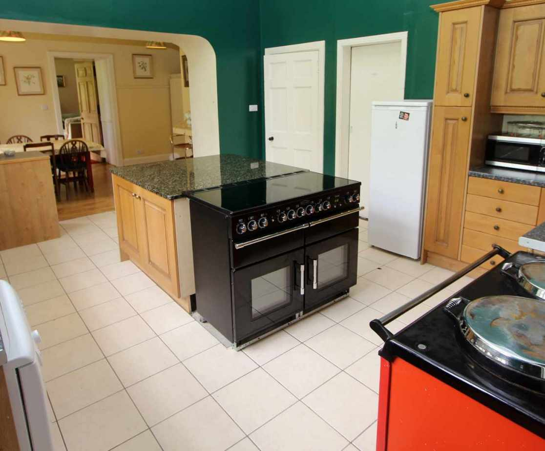 The kitchen is well equipped with an electric cooker and an Aga