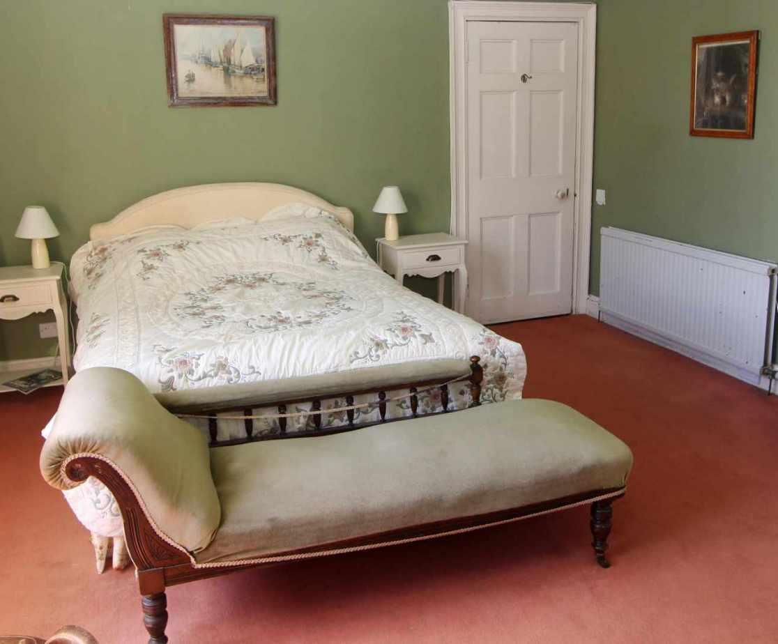 The first floor \'Laird\'s\' double bedroom with an en suite bathroom