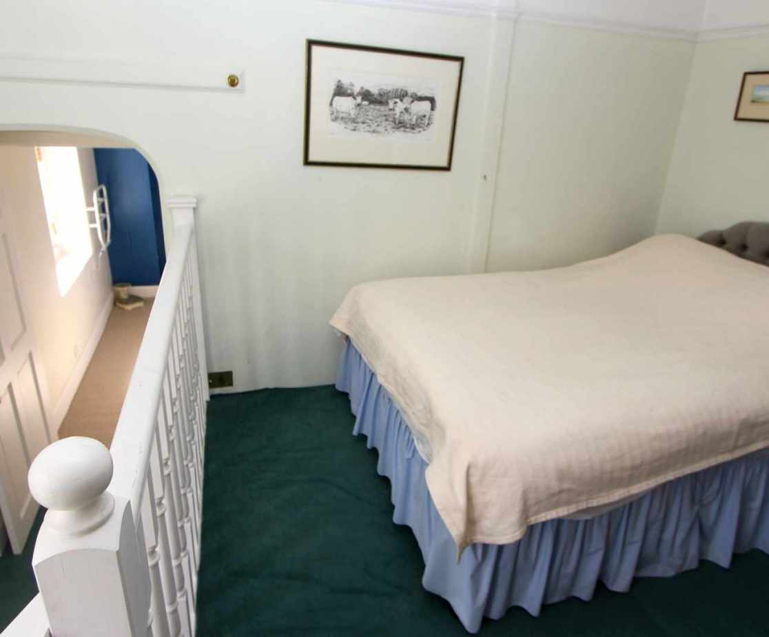 \'Sewing\' room with a double bed has a front view, located on the first floor