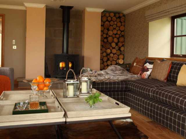 The drawing room with its wood burning stove is a wonderfully cosy place to relax