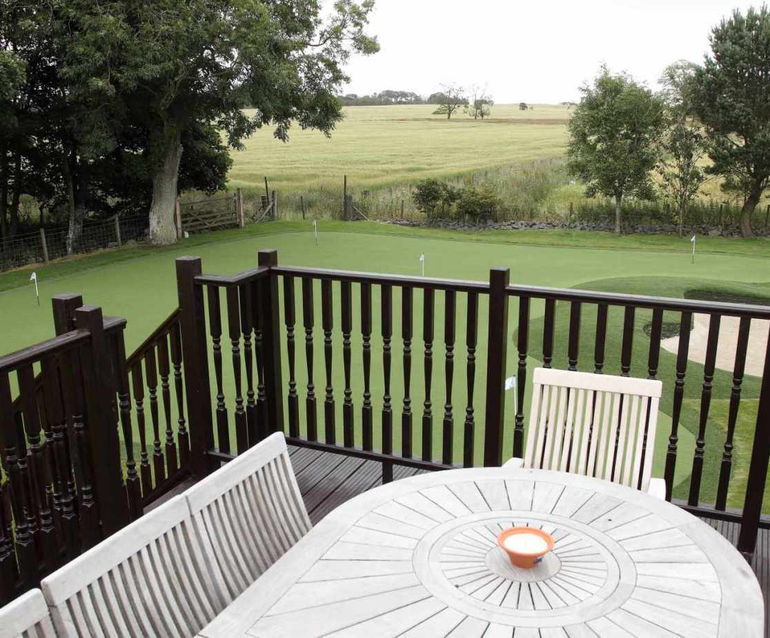 Sit and enjoy the views of the garden and private 5 hole green from the balcony.