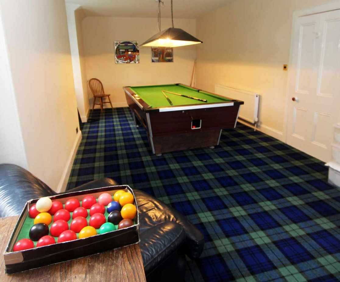 There is a pool table on the first floor which also houses 2 fold out beds