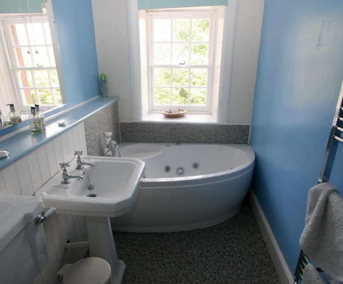 Shared modern bathroom with jacuzzi bath on the second floor