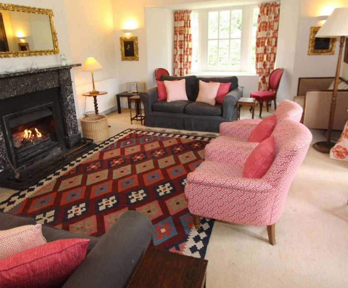 The warmth of an open fire in the drawing room awaits