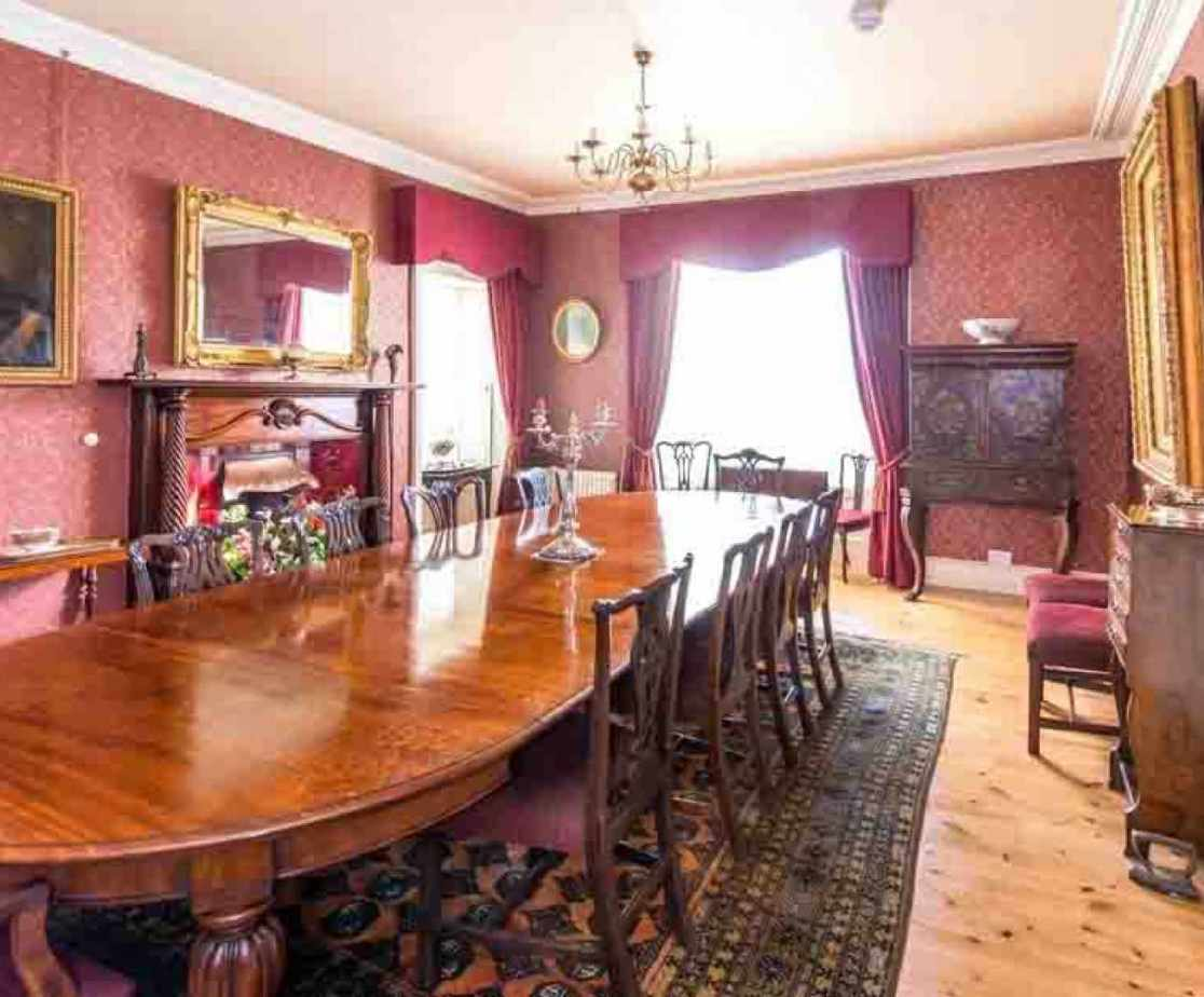 The formal dining room can seat up to 18 people