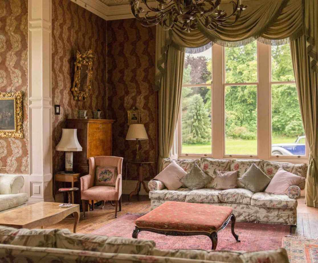 The spacious drawing room with bay windows