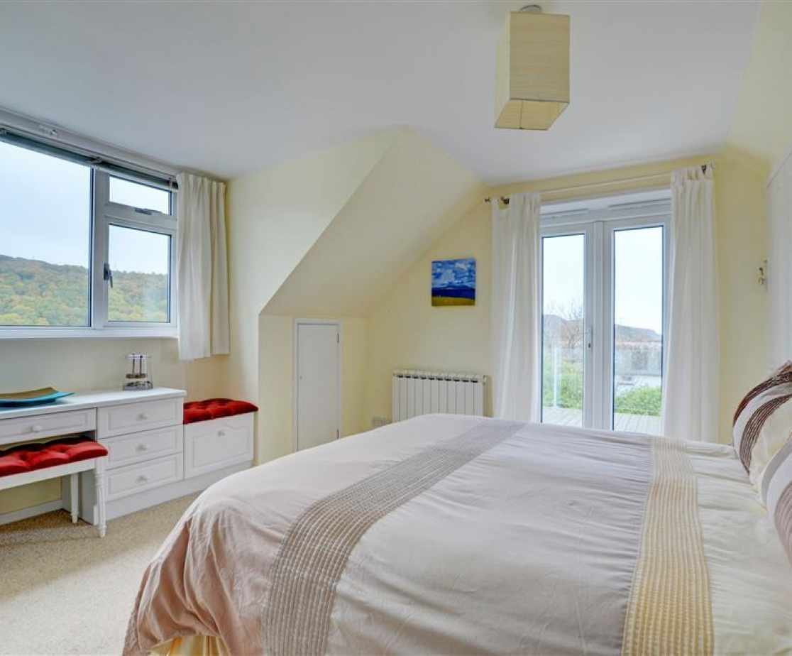Bedroom 5 is dual aspect and is situated on the first floor