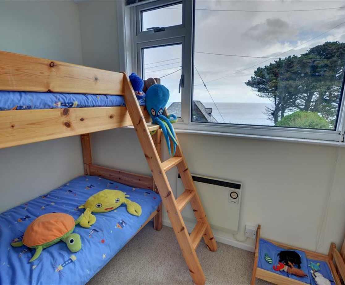 Bedroom 6 with short bunk beds suitable for children