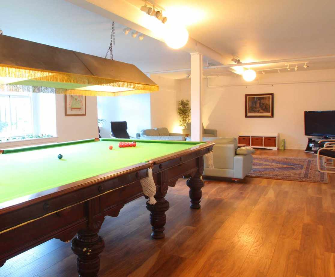 The TV room comes with it\'s very own full size snooker table