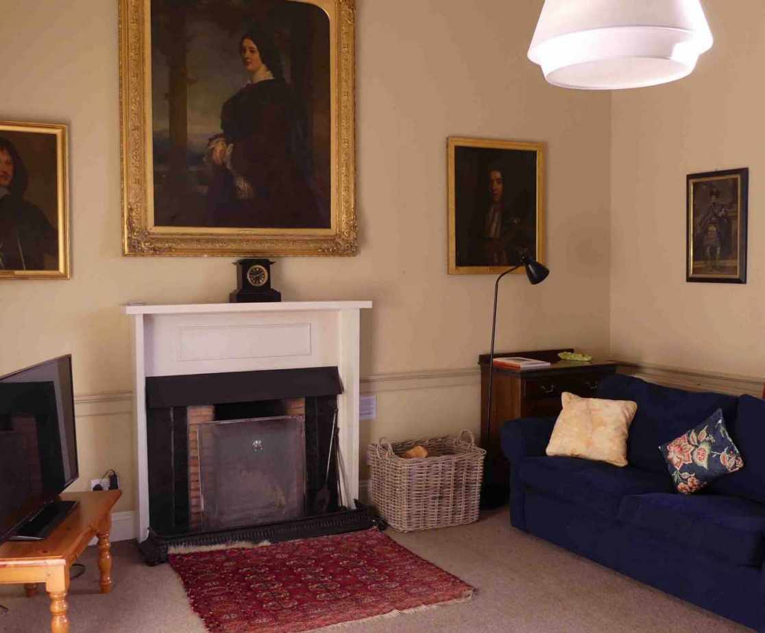 The secondary sitting room with open fire