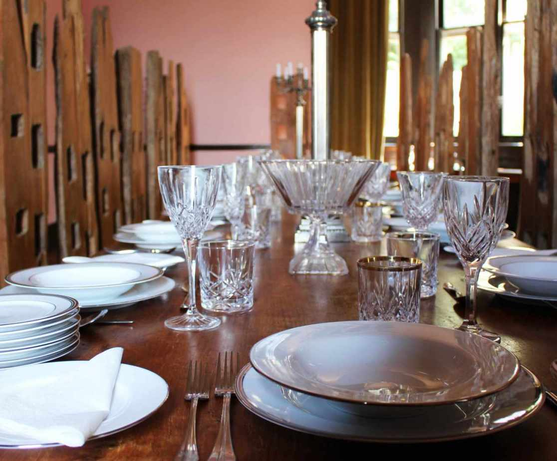 The formal dining room is situated next to the kitchen and seats up to 22 people