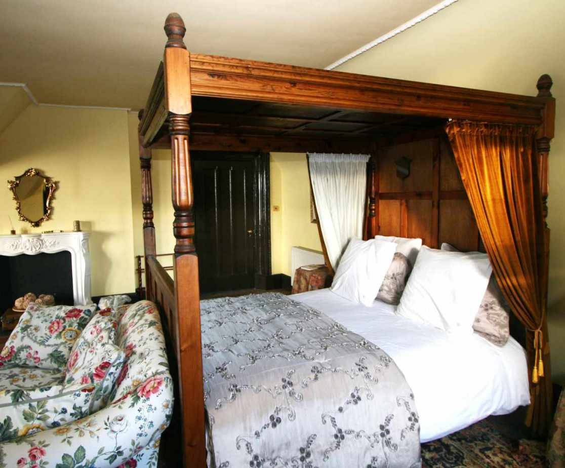 \'Yellow\' bedroom is another of the many four poster bedrooms