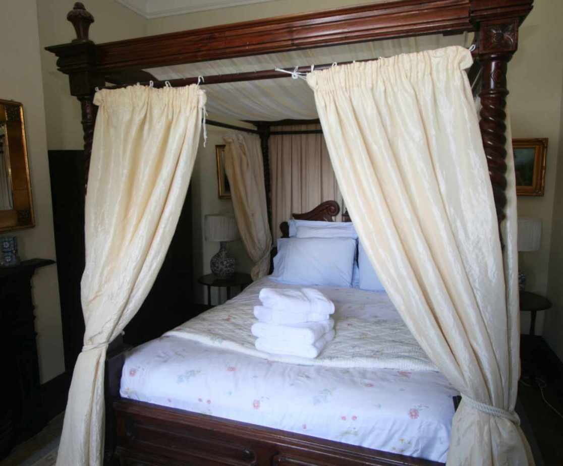 \'Cream\' bedroom with double four poster bed on the first floor