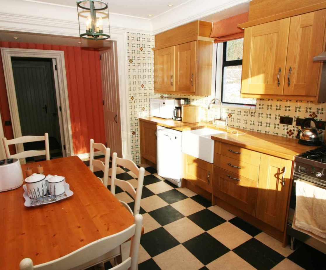 The well presented kitchen with breakfast table