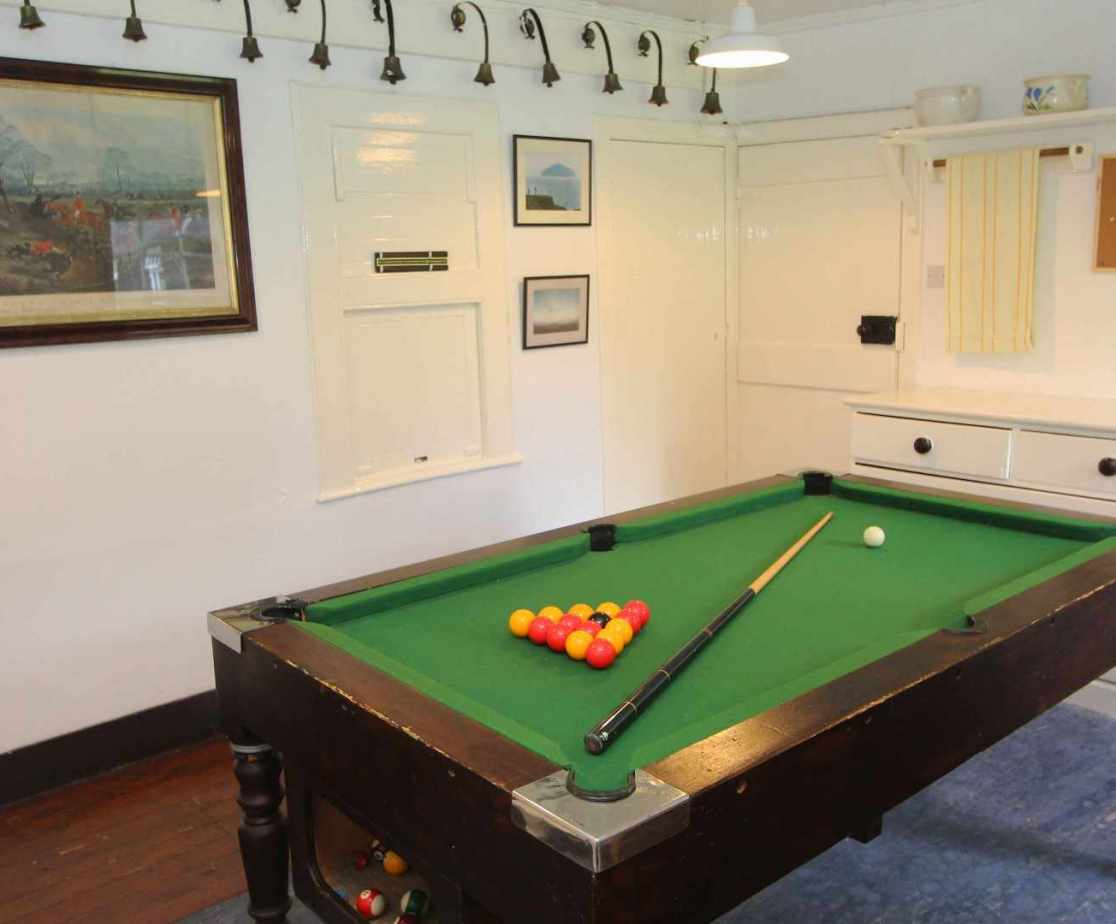 A small pool room is available in the utility hall
