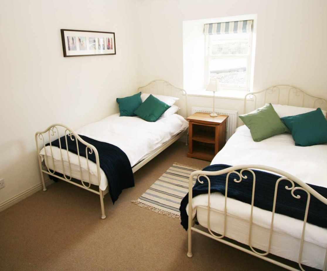 Room 1 is the ground floor twin bedroom