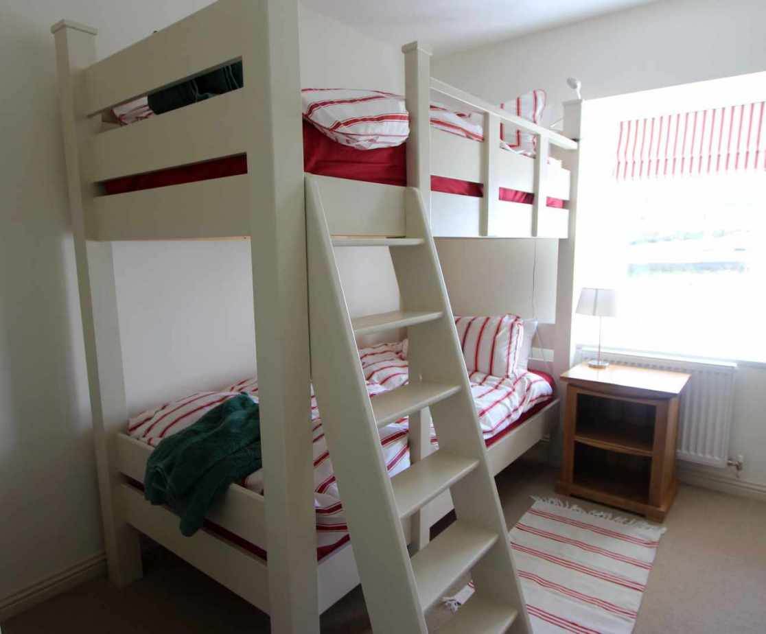 Room 2 is a charming bunk room on the ground floor