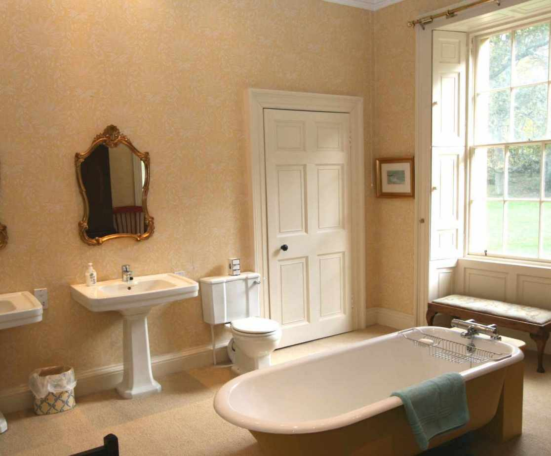 The master bedroom\'s en-suite with roll top and his\'n\'hers basins