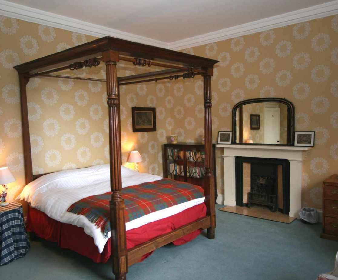 Room 6 on the second floor has a beautiful four poster double bed