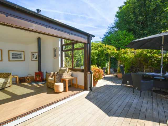 Fantastic new conservatory. bi fold doors open onto decking