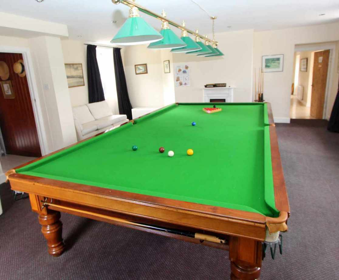 Large games room with a full size snooker table
