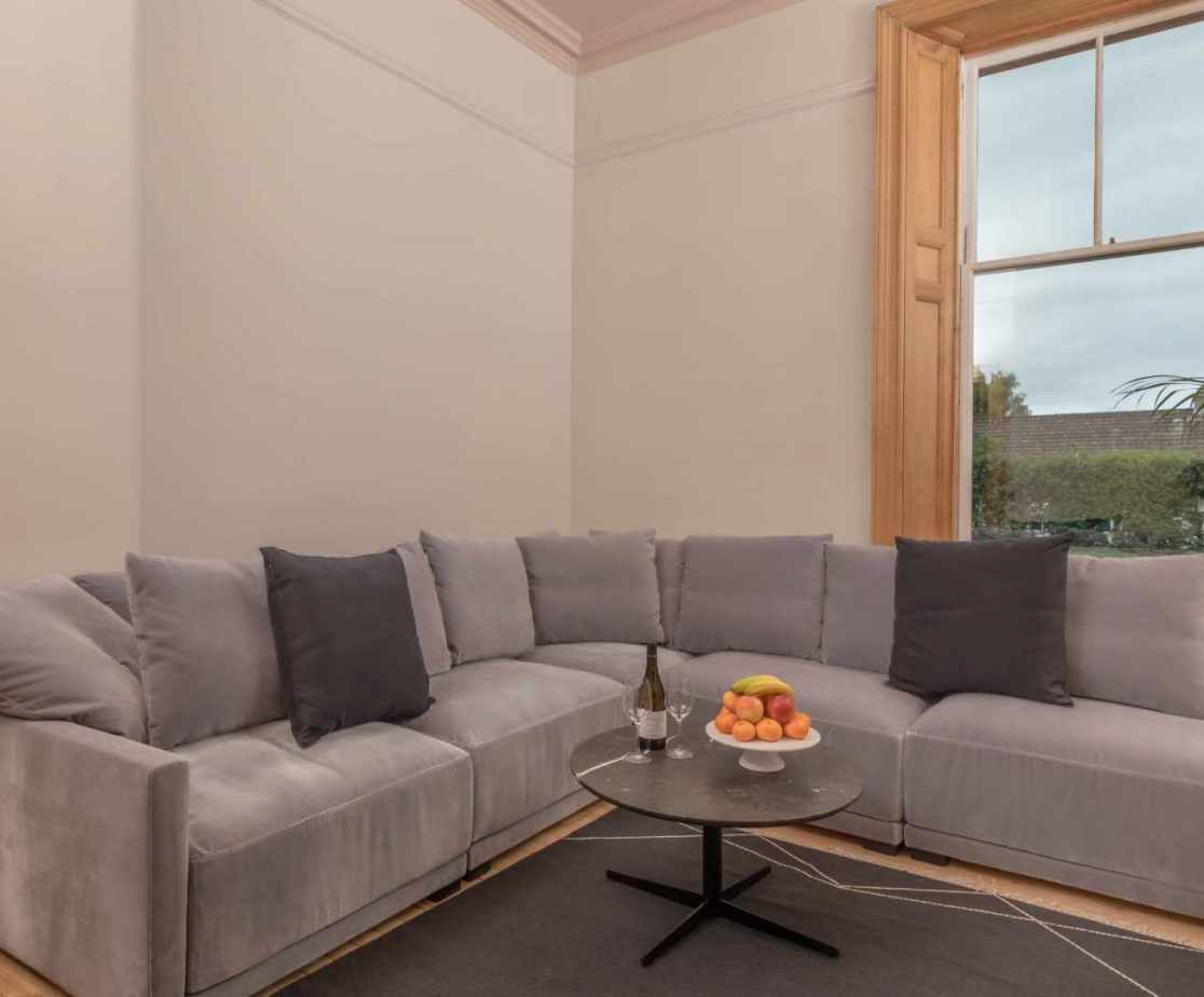 A comfortable secondary reception room to relax infront of a cinema style TV