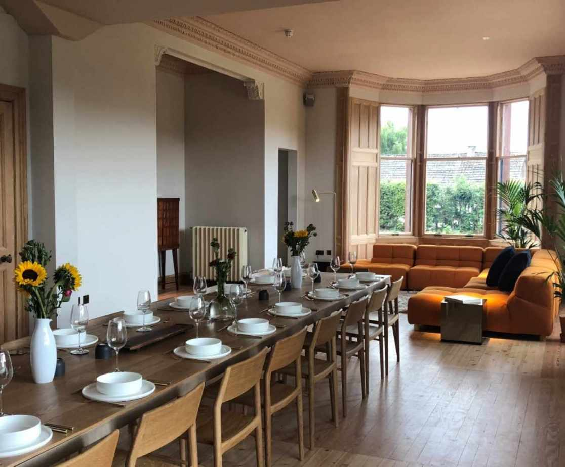 An open plan sitting/dining room provides plenty of space for large groups