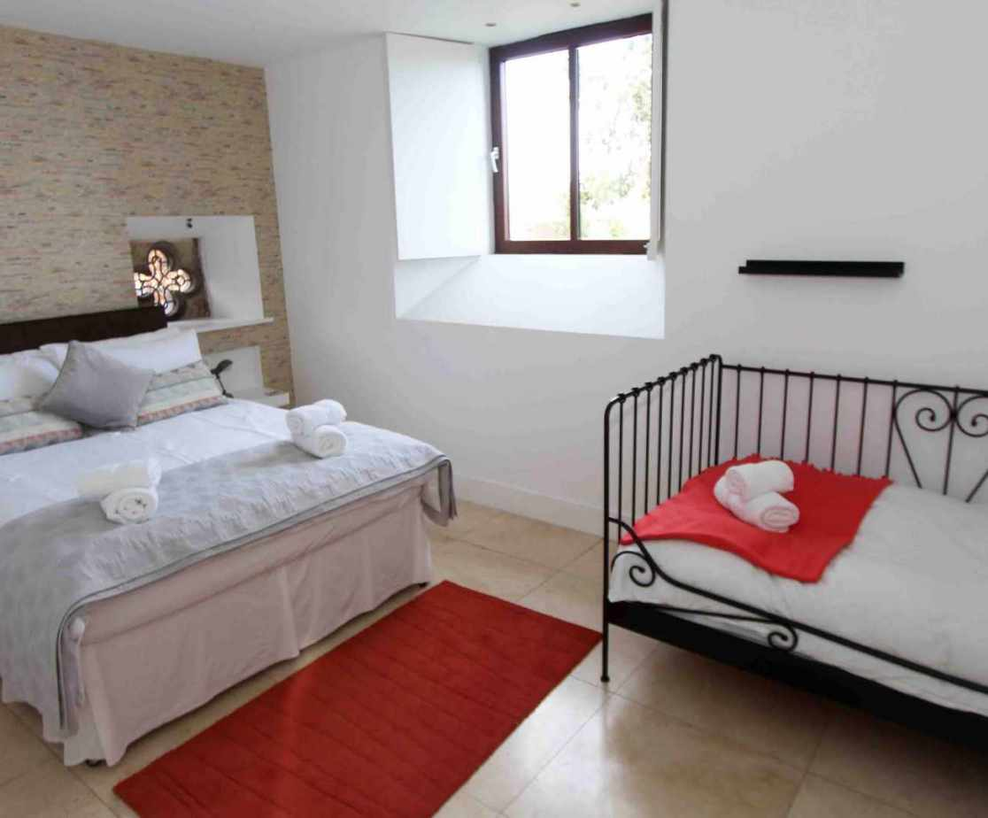 Bedroom 3, a generous double room with chic day bed